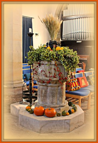 The Church font decorated for Harvest Festival